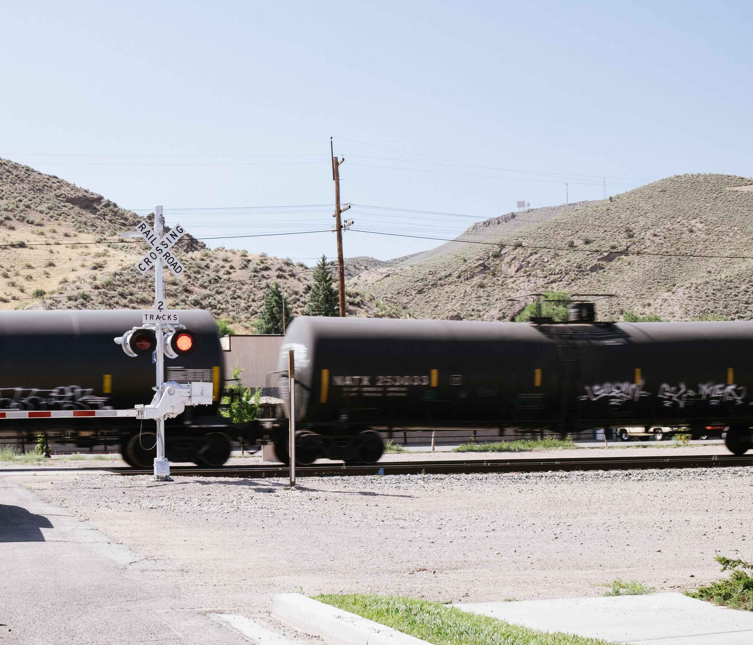 A train passes by Caliente without so much as a stop, only halting traffic for a brief moment.