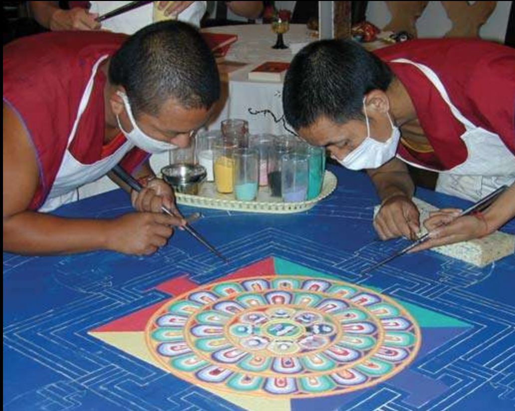 6. Monks creating a Sand mandala.png