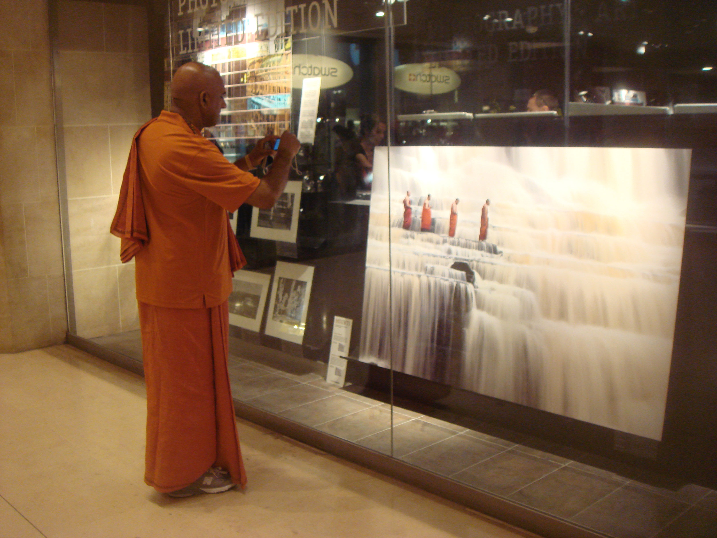 A living, breathing Buddhist monk encounters a large-scale photograph of Buddhist monks crossing a stream. Real and still. Makes me think of Verse 15 from the Tao te Ching:   The ancient Masters were profound and subtle.    Their wisdom was unfathomable.    There is no way to describe it;    all we can describe is their appearance.         They were careful    as someone crossing an iced-over stream.    Alert as a warrior in enemy territory.    Courteous as a guest.    Fluid as melting ice.    Shapable as a block of wood.    Receptive as a valley.    Clear as a glass of water.         Do you have the patience to wait    till your mud settles and the water is clear?    Can you remain unmoving    till the right action arises by itself?         The Master doesn't seek fulfillment.    Not seeking, not expecting,    she is present, and can welcome all things.   Stephen Mitchell translation