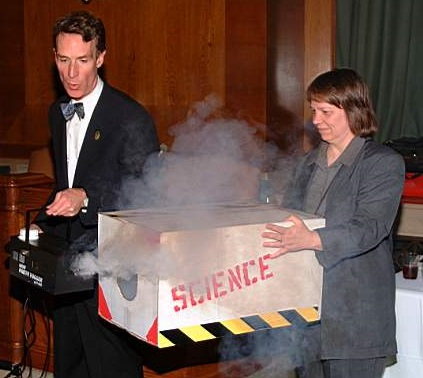 Author holding a box of SCIENCE for Bill Nye, The Science Guy.