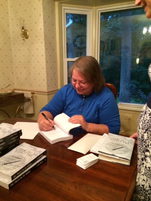 K. Sena Makeig signing books at her recent Book Launch Party.