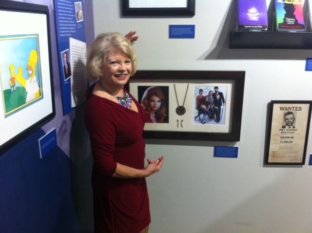 Kathy shows off her Family Affair memorabilia hung in The Paul Lisnek gallery wing of the Museum of Broadcast Communications in Chicago.