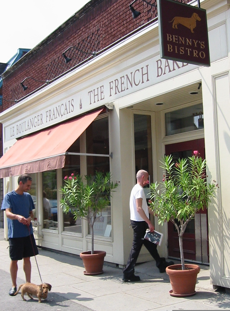 On the left, the founding owner and original French Baker, Jérôme Mantel and his dog Benny whose name adorns our bistro.