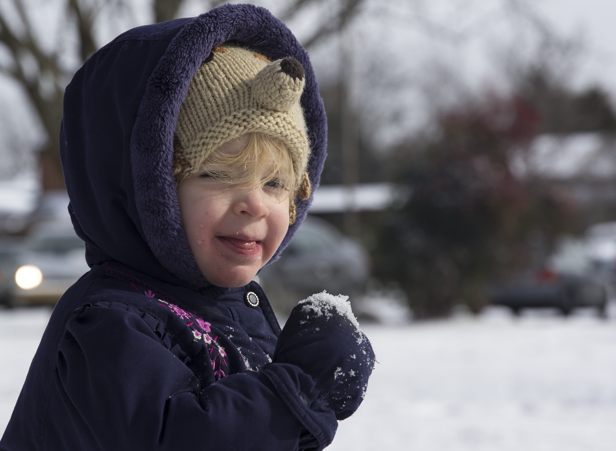 "It's the first snow that 2 and a half-year-old Del McGee can say the word snow. On Wednesday, January 29, 2014, Del and her mom Cordon Folds McGee take a trip to Weaver Street Market in Carrboro, N.C. to play. ""She's going to freeze her mouth in all this snow,"" says McGee. ""And that's her hedgehog hat. Her favorite animal in the whole world."""