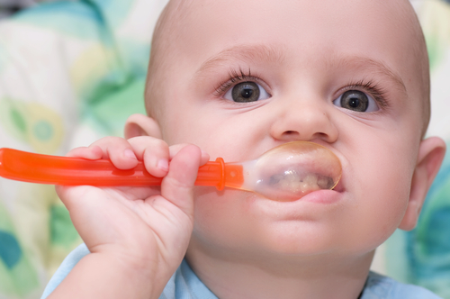 baby eating with spoon small.jpg