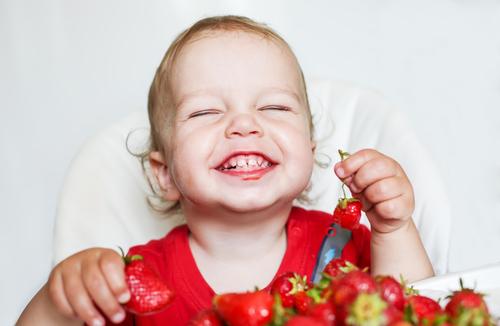 toddler eating strawberries small.jpg