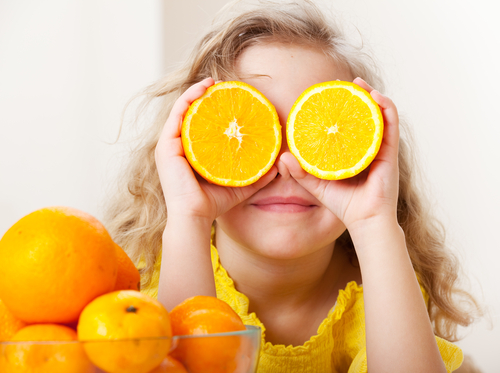 girl with oranges for eyes small.jpg