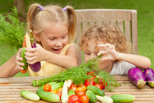 boy and girl playing with vegetables small.jpg