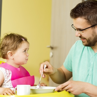 father and toddler eating small.jpg
