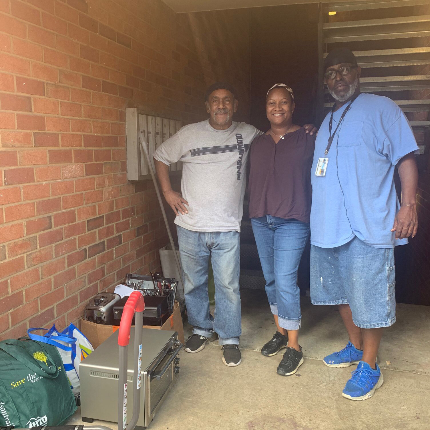 COSF Peer Navigators Tammie and Steve helping a homeless veteran get set up in his new apartment.