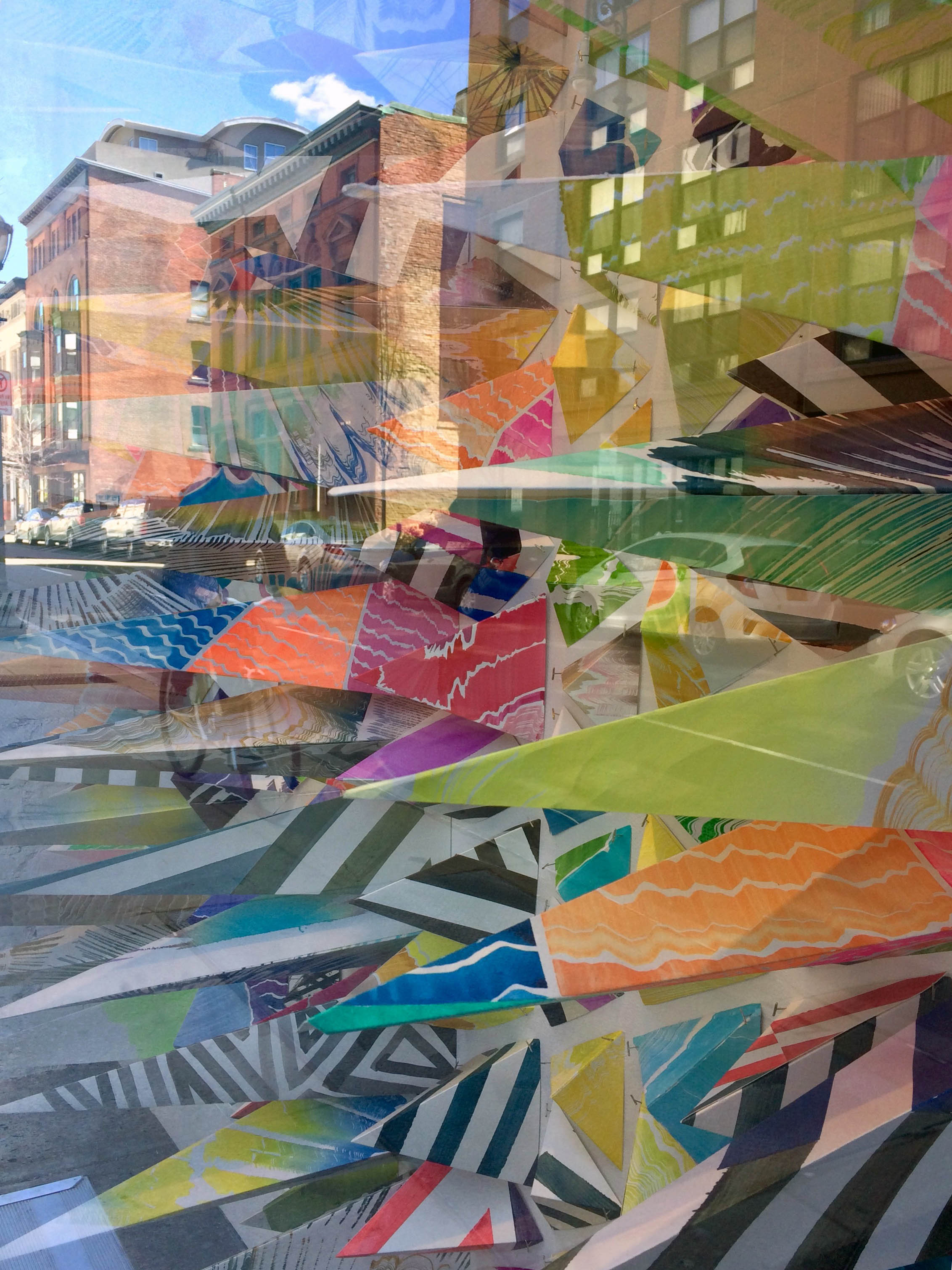 A view of the installation from outside with the reflections of the city
