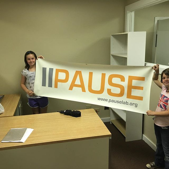 The new PauseLab office with an old banner.  Can't wait to get started.