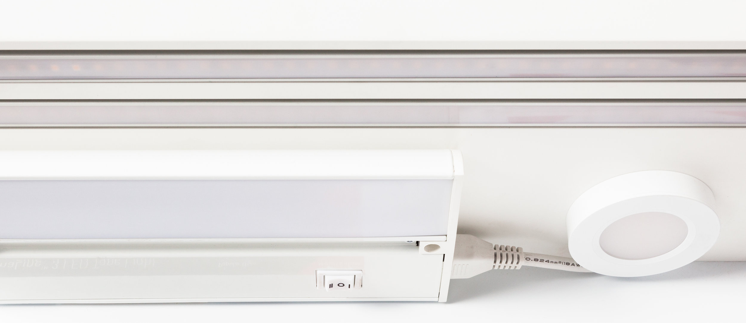 A selection of shelf mounted lights show the quality of the light projected onto a counter surface, at the standard cabinet height.