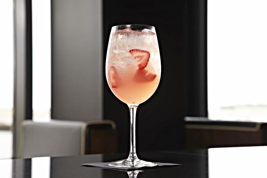Strawberry Sangria  (Skyy Wild Strawberry Vodka, Massenez Crème de Fraise, Campari, botanicals, moscato, lemon, sugar - $11)