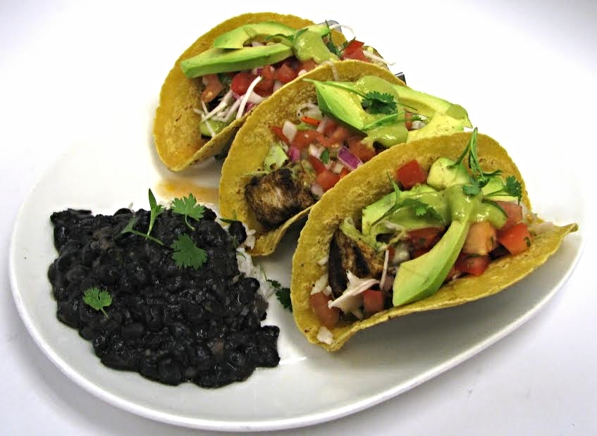 Blackened Swordfish Tacos  (avocado, pickled cabbage, chipotle mayo, black beans, rice - $16.95)