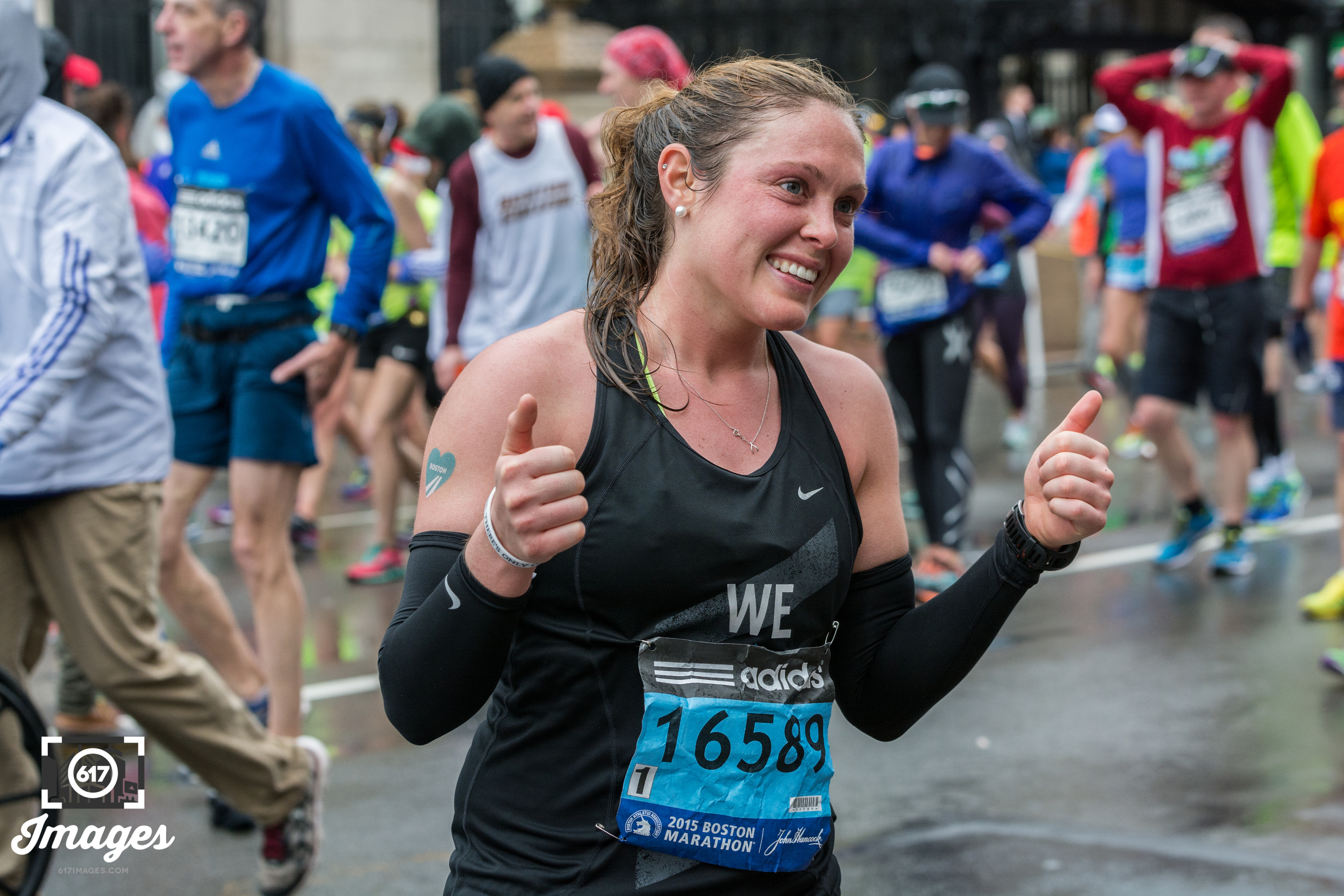 Thumbs up on finishing the marathon.