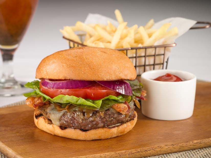 TAMO Bistro + Bar      TAMO Burger    –     Cheddar Cheese, Caramelized Onion, Bacon, Lettuce, Tomato, Brioche Bun