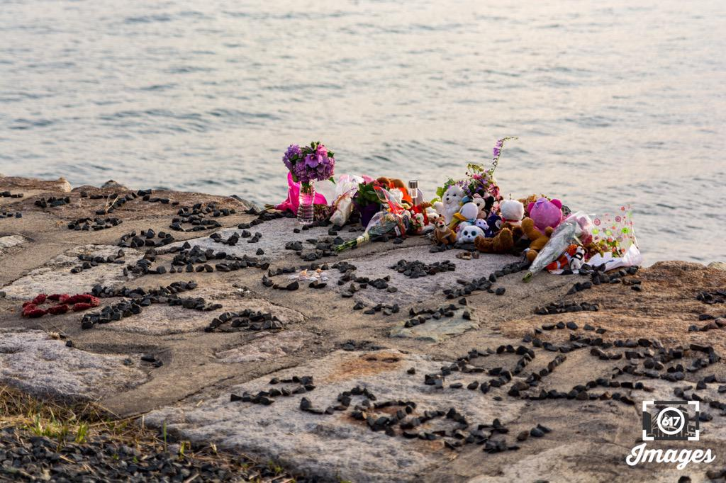 Stuffed animals, toys, flowers and messages left with rocks for 'Baby Doe'
