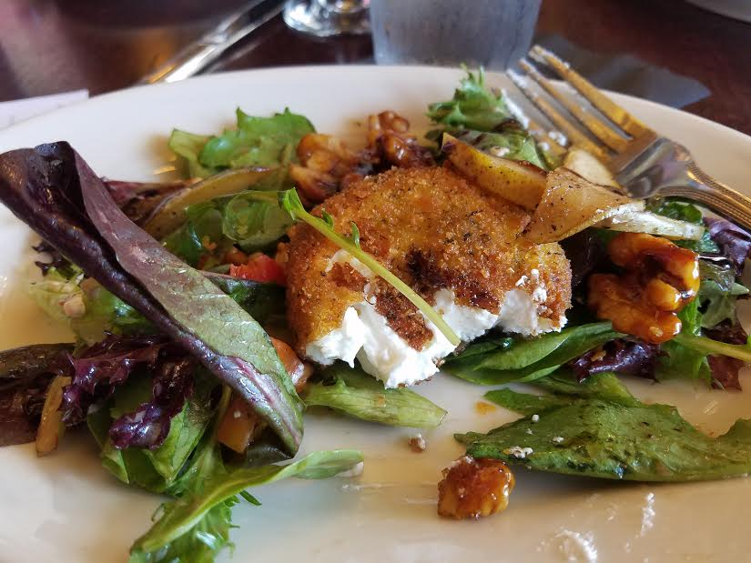 Caramelized pear salad with encrusted goat cheese.