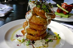 """""""Crooked [Hillary] Tree IPA Battered Onion Rings"""" with a private server of dipping sauces"""