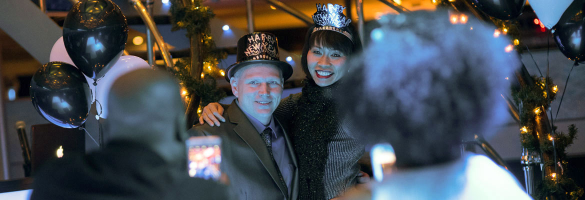 new-years-eve-couple-with-hats.jpg