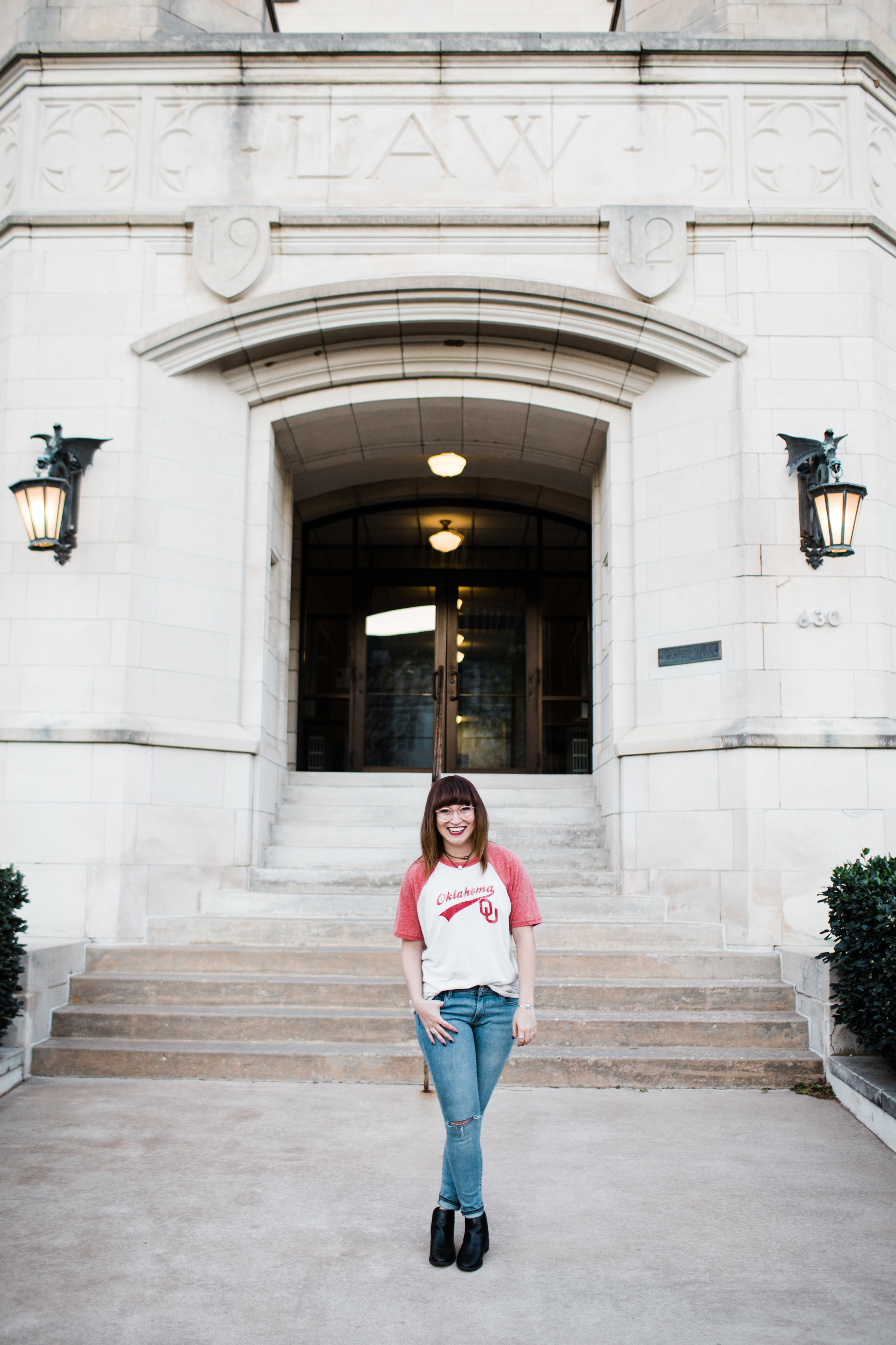 senior picture posing in front of building