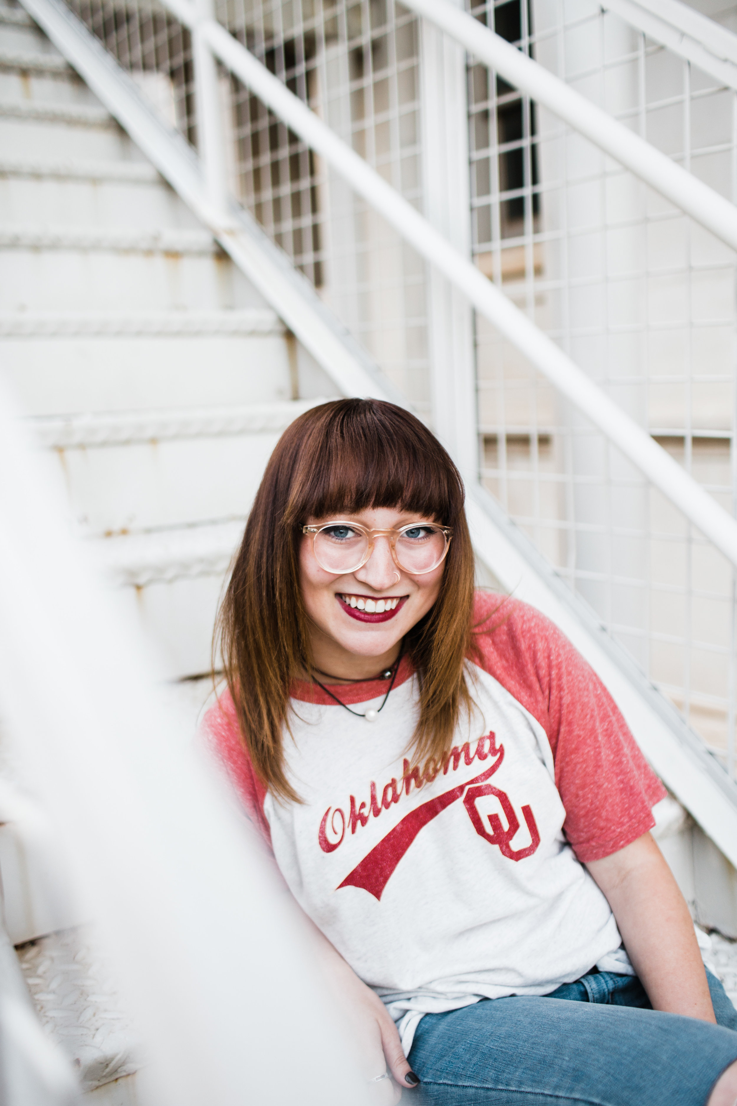 Senior girl posing on stairs