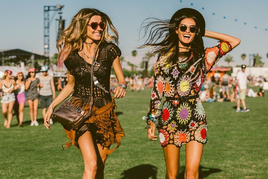 Everything about this picture is Coachella perfect! Love the dress on the right.
