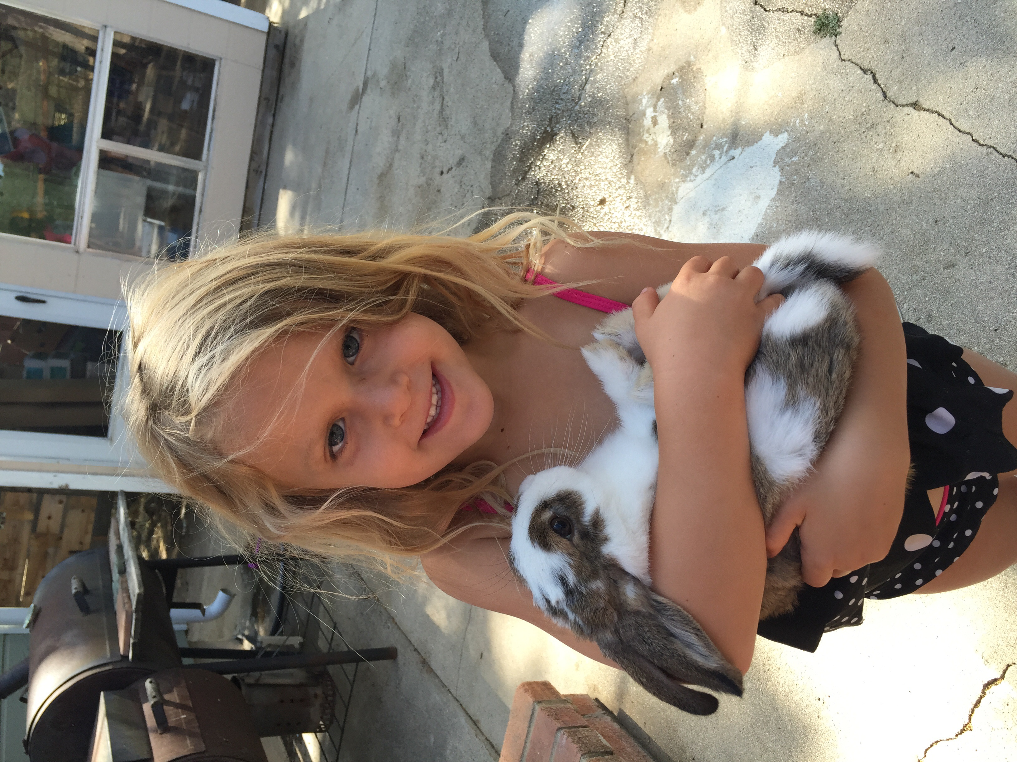 Here's Iris holding the bunny - his name is Snuggles. Moses goes around saying the bunny is his son- Lol!