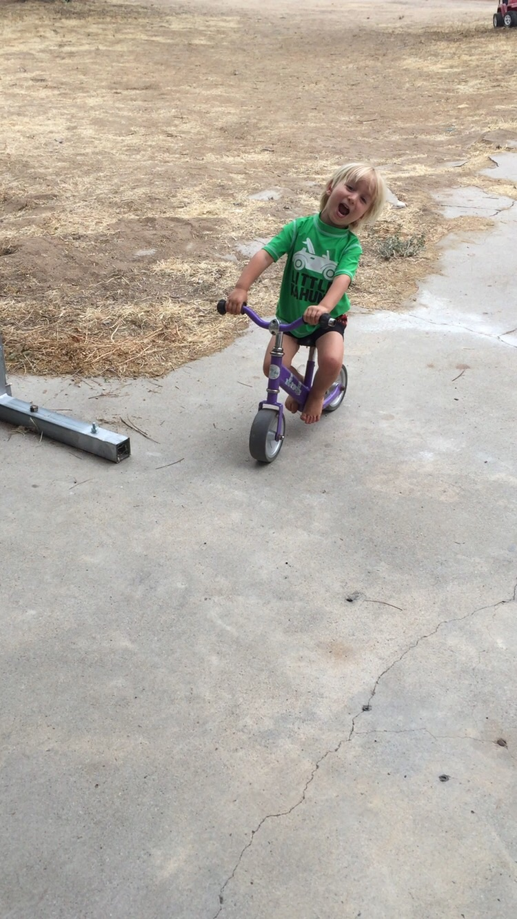 Moses on his favorite bike... He's such a goof ball!!