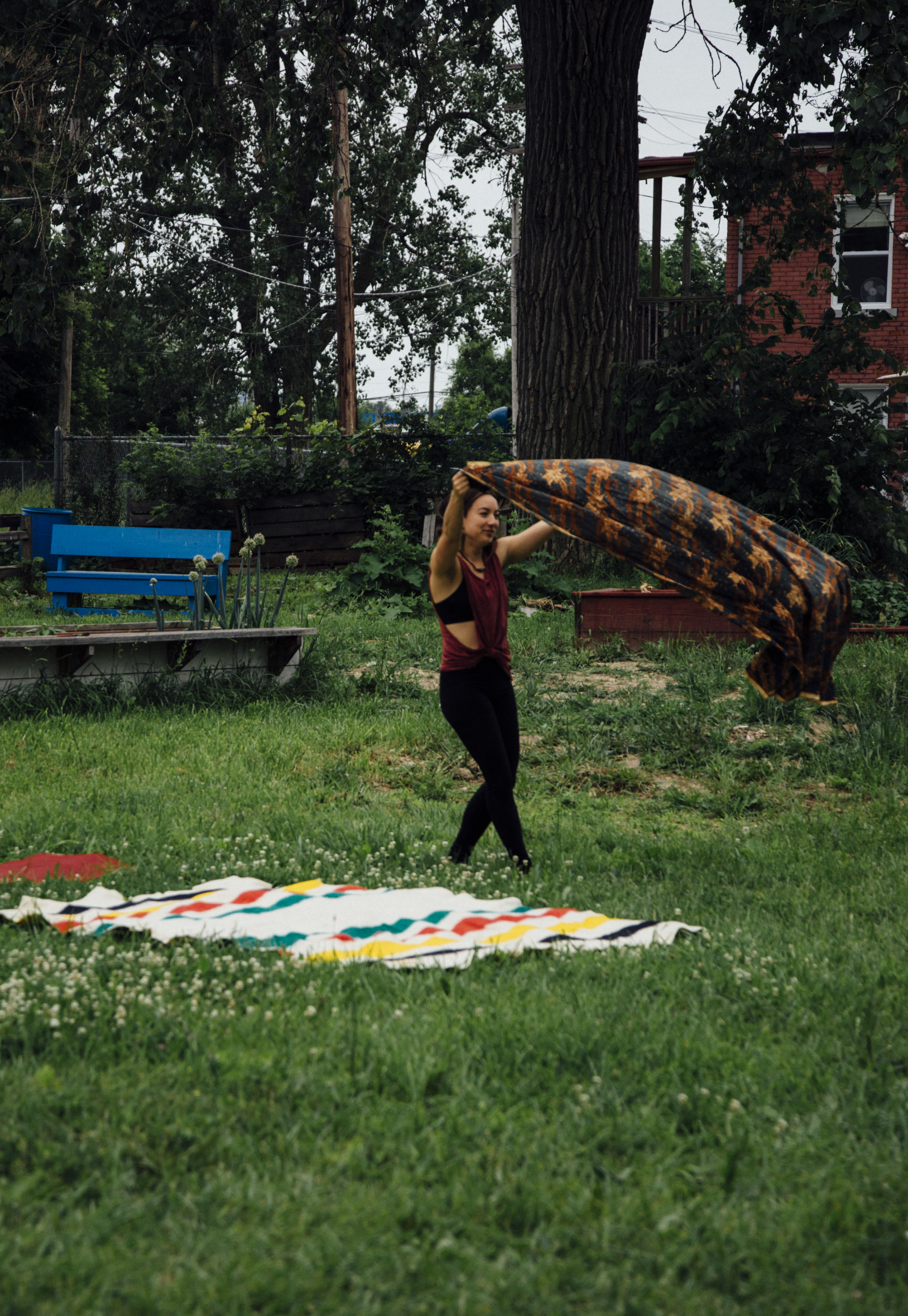 Monica LaFlamme, setting up blankets for the acro-yoga group.                            photo: ee berger