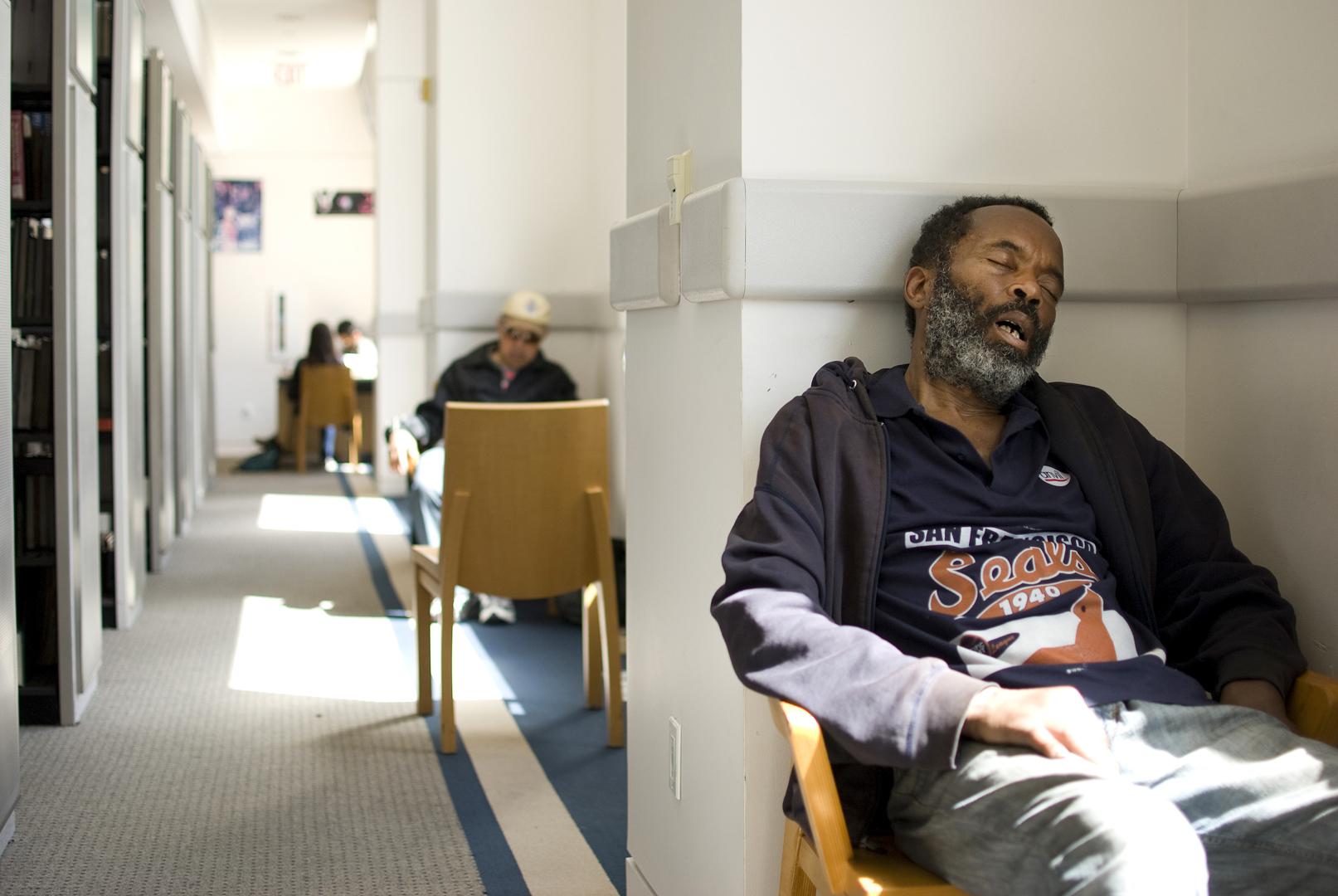 A San Francisco Public Library patron takes a mid-day nap at the Main Branch. San Francisco, CA.