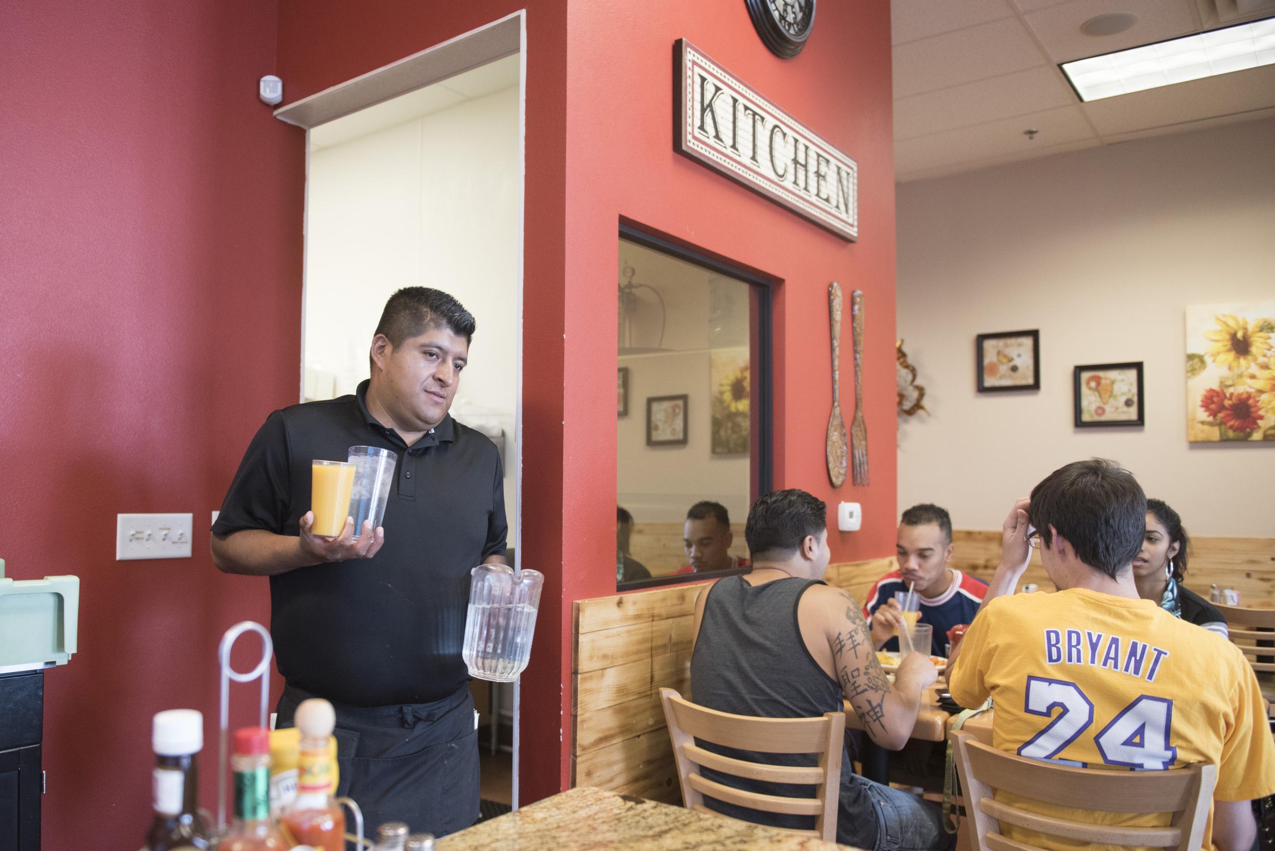 Restaurant manager, Efrain Joachin, brings food to customers at BabyStacks in Henderson, Friday, June 26, 2015.(Jason Ogulnik/Las Vegas Review-Journal)