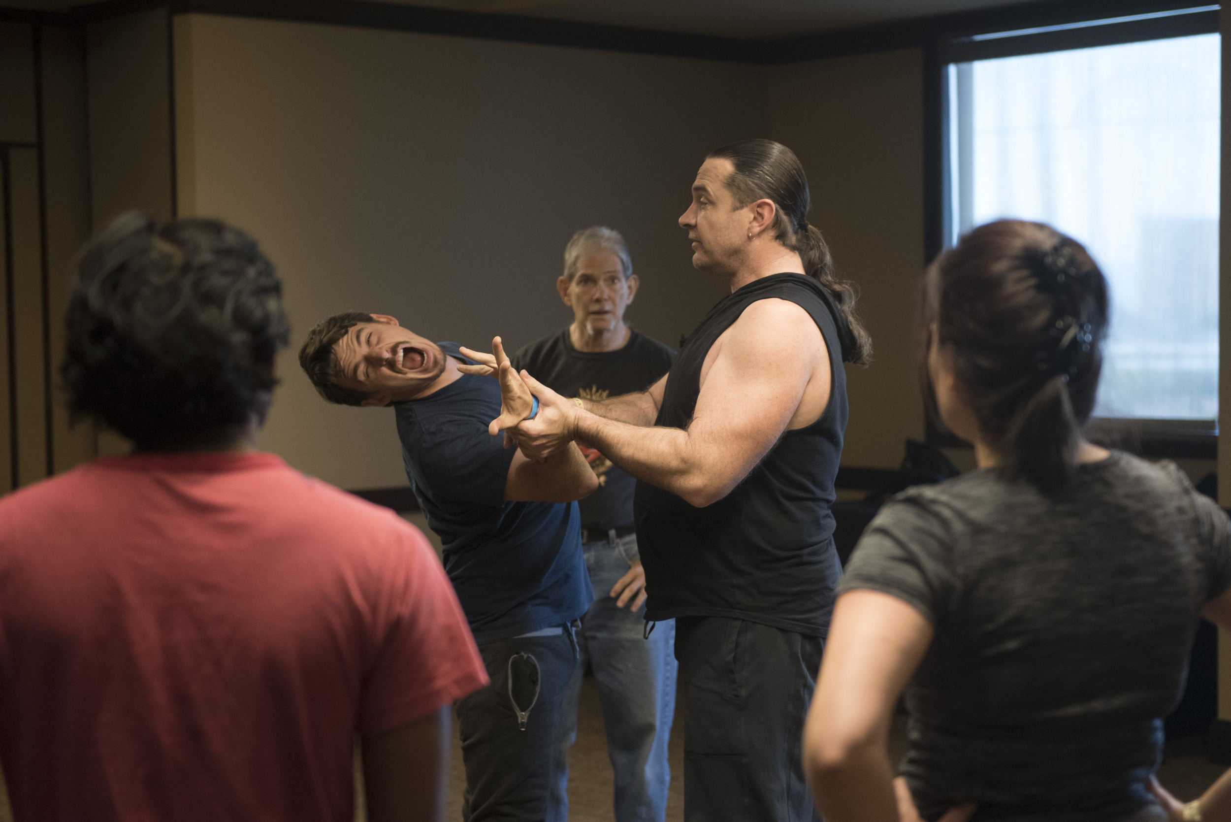Kyle Rowling, fourth from left, teaches a takedowns class at CombatCon at The Palms Resort and Casino in Las Vegas, Saturday, June 27, 2015.(Jason Ogulnik/Las Vegas Review-Journal)