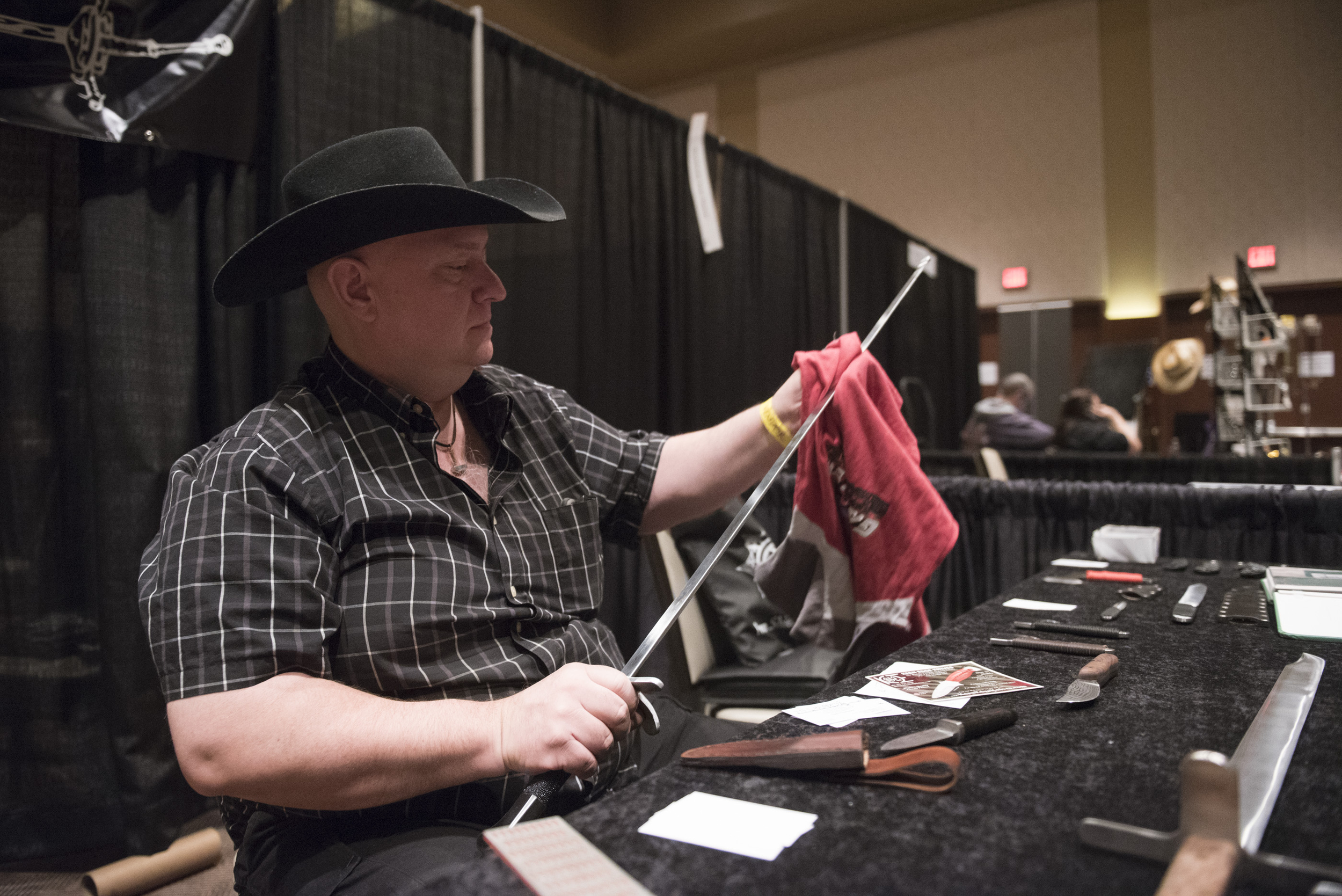 Garth Thompson of the Calgary, Canada area S.G.T. Blades cleans fingerprints off of his handmade sword at CombatCon at The Palms Resort and Casino in Las Vegas, Saturday, June 27, 2015.(Jason Ogulnik/Las Vegas Review-Journal)