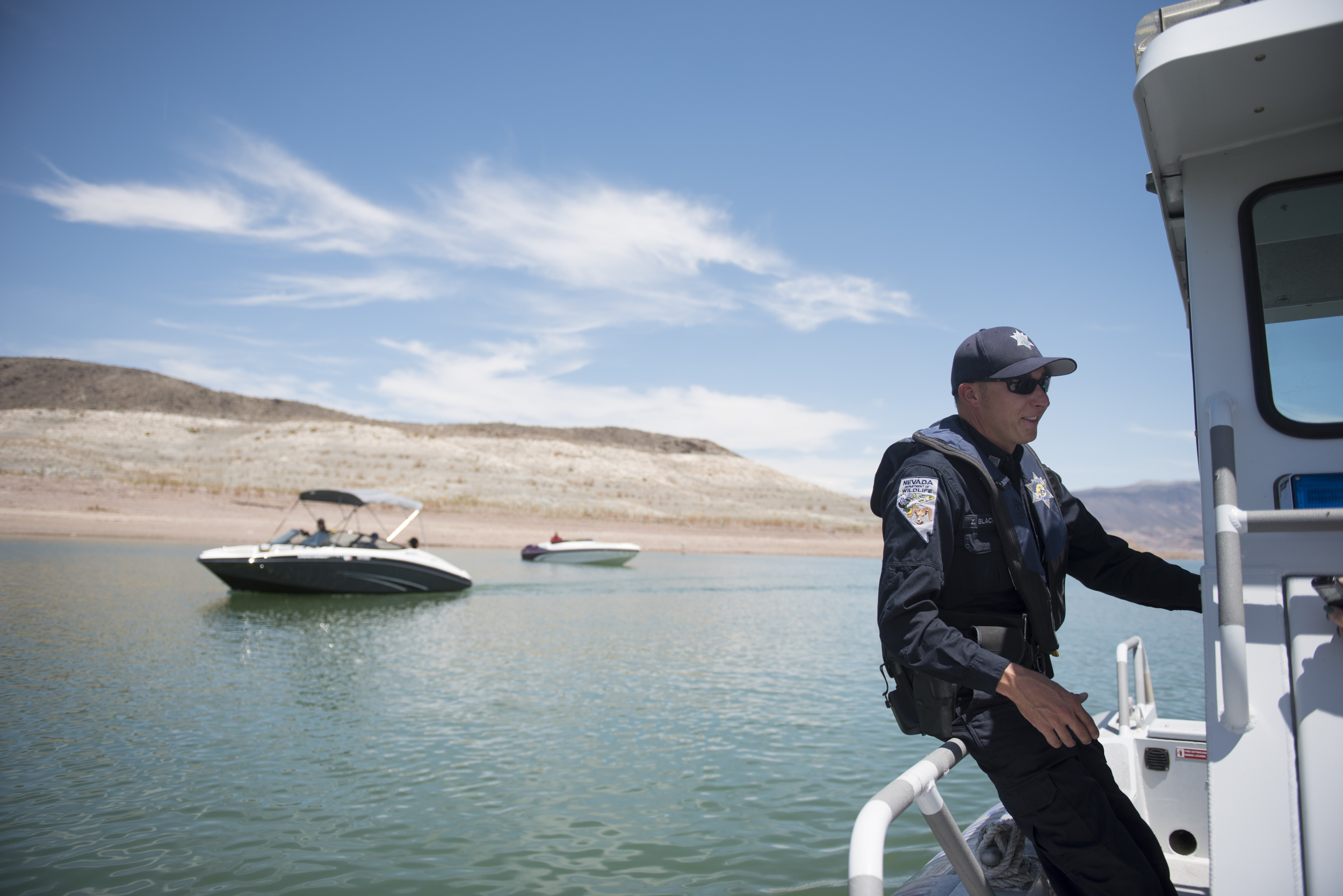 Zach Blackwood, game warden/police officer with the Nevada Department of Wildlife, gives a tour showing Lake Mead's receding waterline and the dangers it poses to boaters in Boulder City, Friday, July 3, 2015.(Jason Ogulnik/Las Vegas Review-Journal)