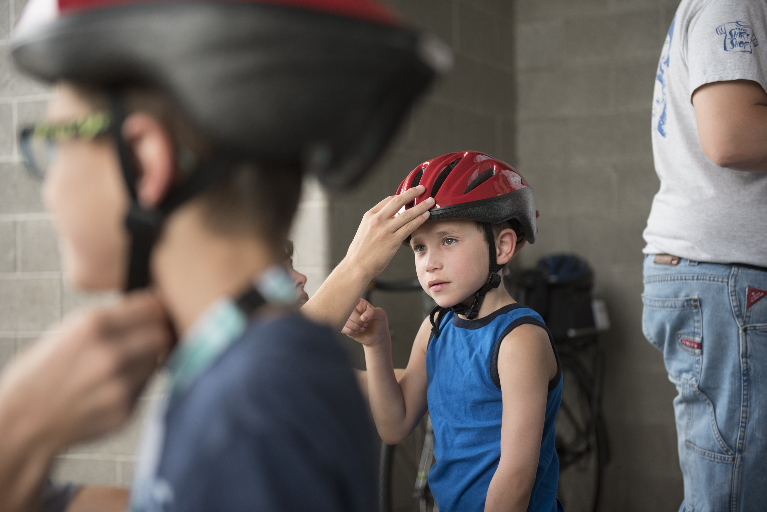 Matthew Freedman, 6, center, gets fitted for a bicycle helmet at the bicycle helmet giveaway at Black Mountain Recreation Center in Henderson, Saturday, July 18, 2015.(Jason Ogulnik/Las Vegas Review-Journal)