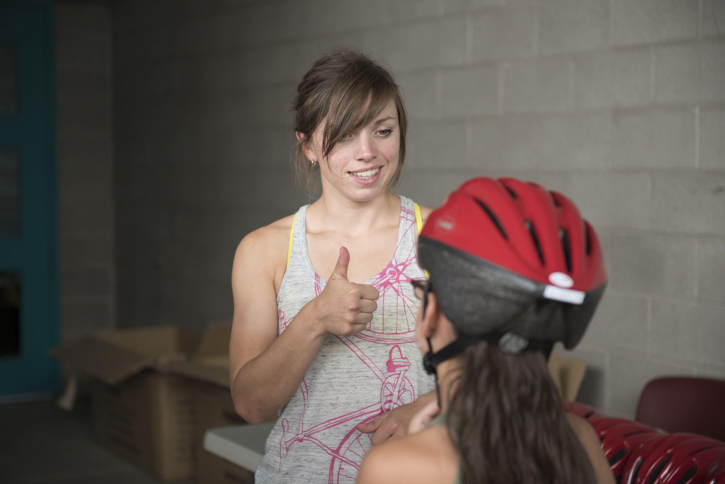 Lisa Leonard gives a thumbs up to indicate a bike helmet that fits well at thehelmet giveaway at Black Mountain Recreation Center in Henderson, Saturday, July 18, 2015.(Jason Ogulnik/Las Vegas Review-Journal)
