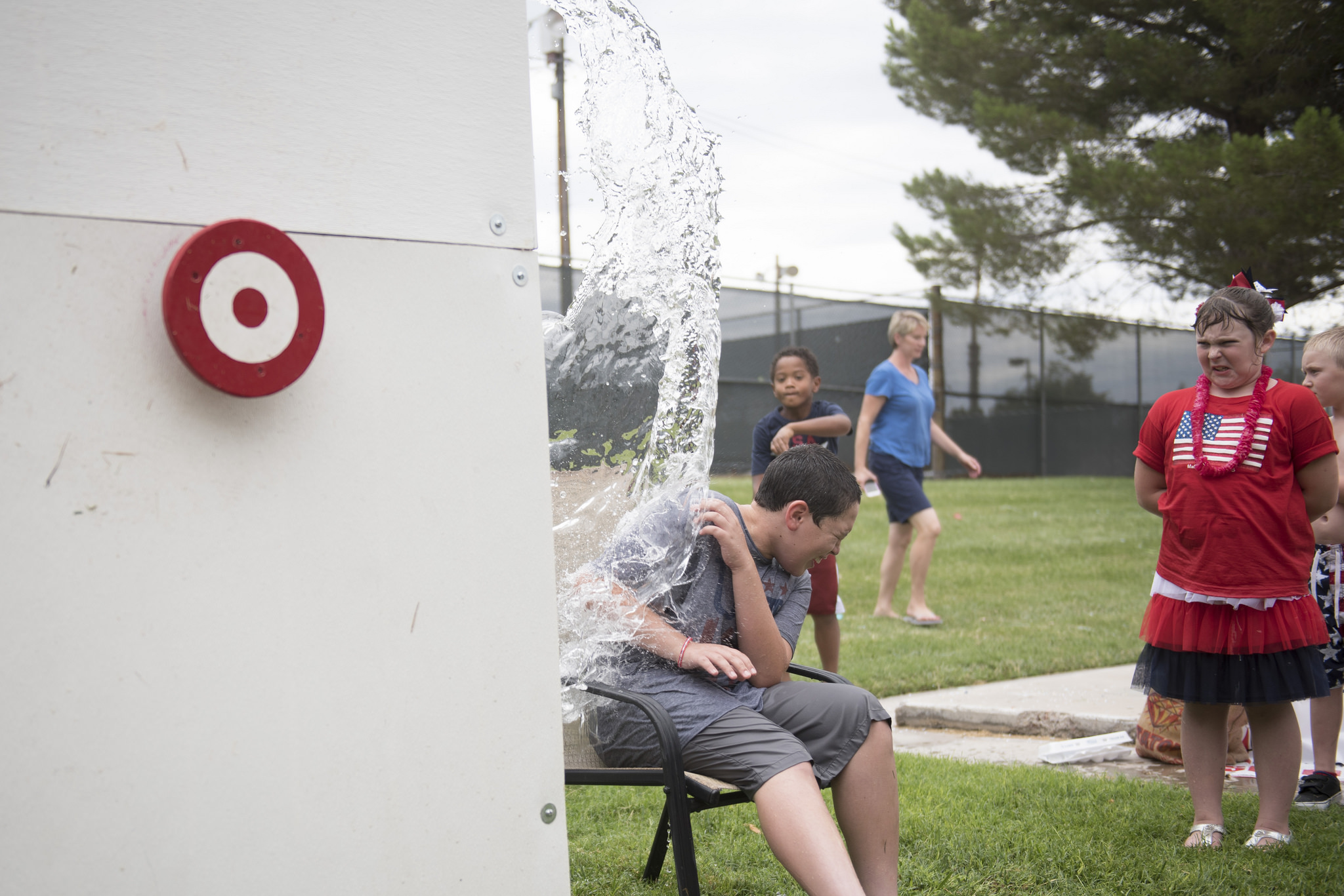 A young teenager participates in a water bucket game at Broadbent Park during the 67th Annual Boulder City Damboree Celebration in Boulder City, Saturday, July 4, 2015.(JASON OGULNIK/BOULDER CITY REVIEW)