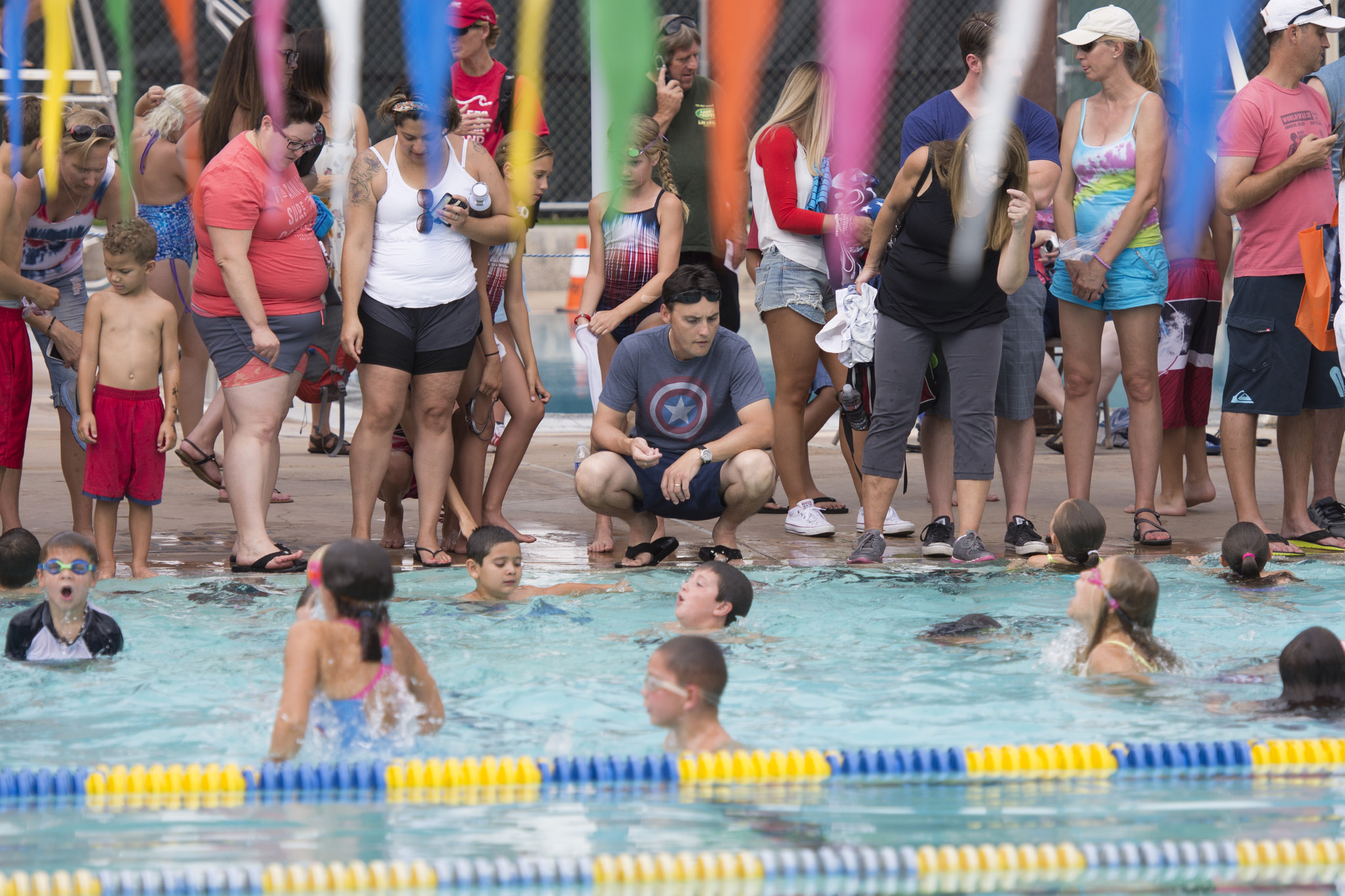 The 9 years old and under league participates in the coin dive at Broadbent Park Pool during the 67th Annual Boulder City Damboree Celebration in Boulder City, Saturday, July 4, 2015.(JASON OGULNIK/BOULDER CITY REVIEW)