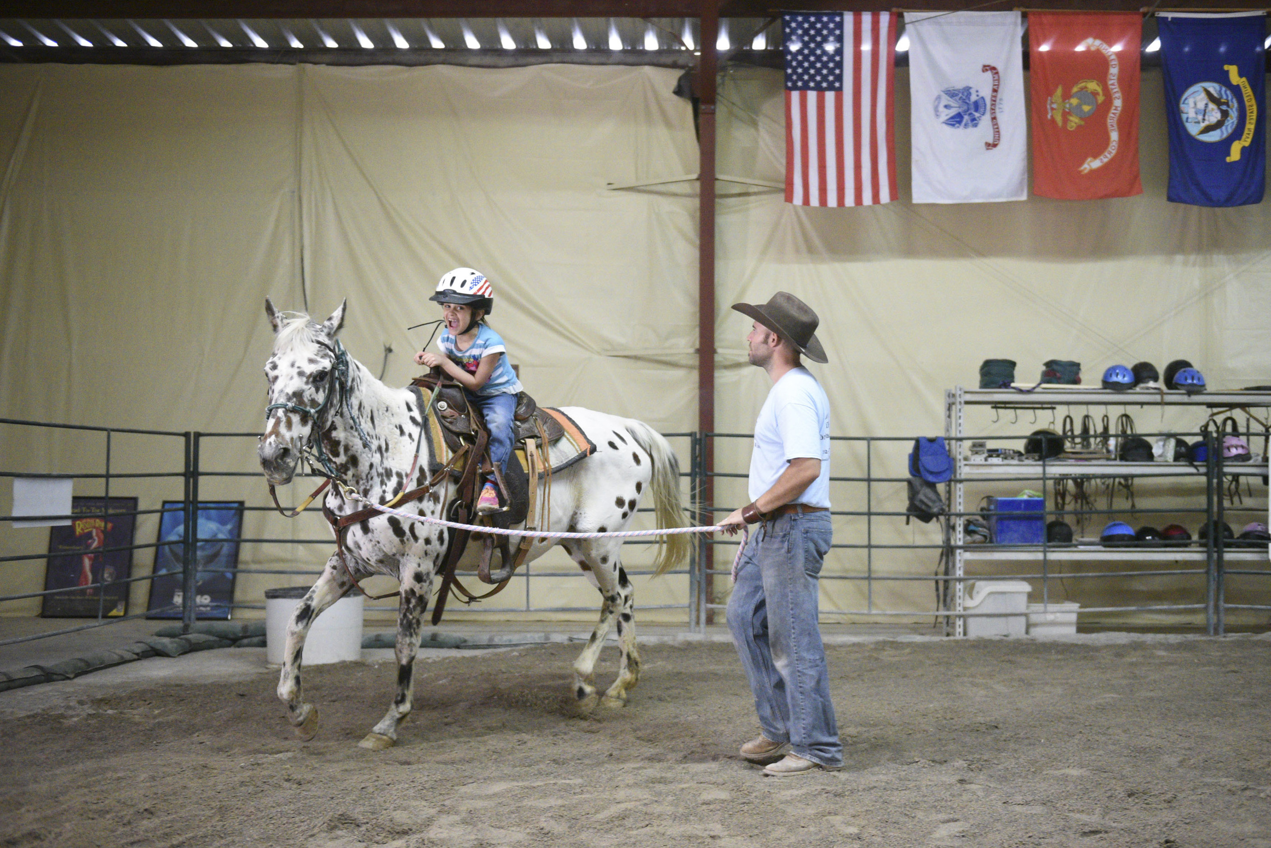 Horse Assisted Therapy (HAT) participant, Sophia Nola Hudig, 7, left, and Paul Rogers, owner of Paradise Ranch in Las Vegas, take Pocahontas for a trot, Wednesday, June 3, 2015. Hudig, who has been diagnosed with autism and ADHD, has been part of the Ranch's HAT program on a scholarship for three years. (Jason Ogulnik/Las Vegas Review-Journal)