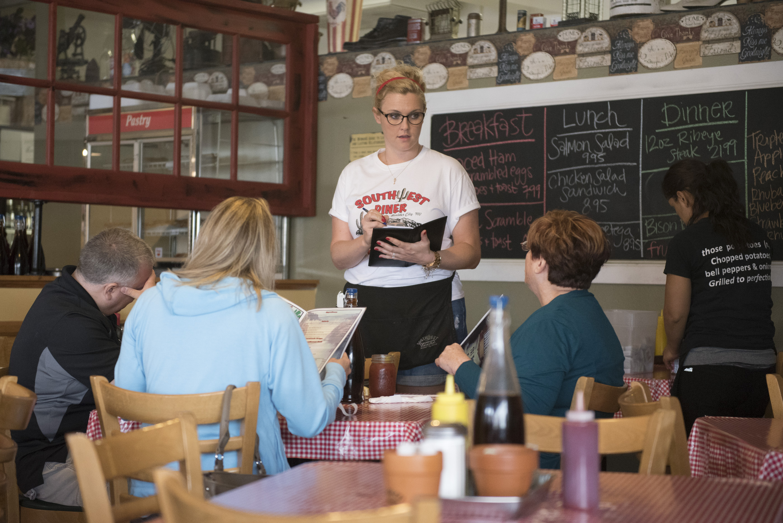 Sara Ford, center, takes customers orders at Southwest Diner in Boulder City, Saturday, July 18, 2015.(Jason Ogulnik/Las Vegas Review-Journal)