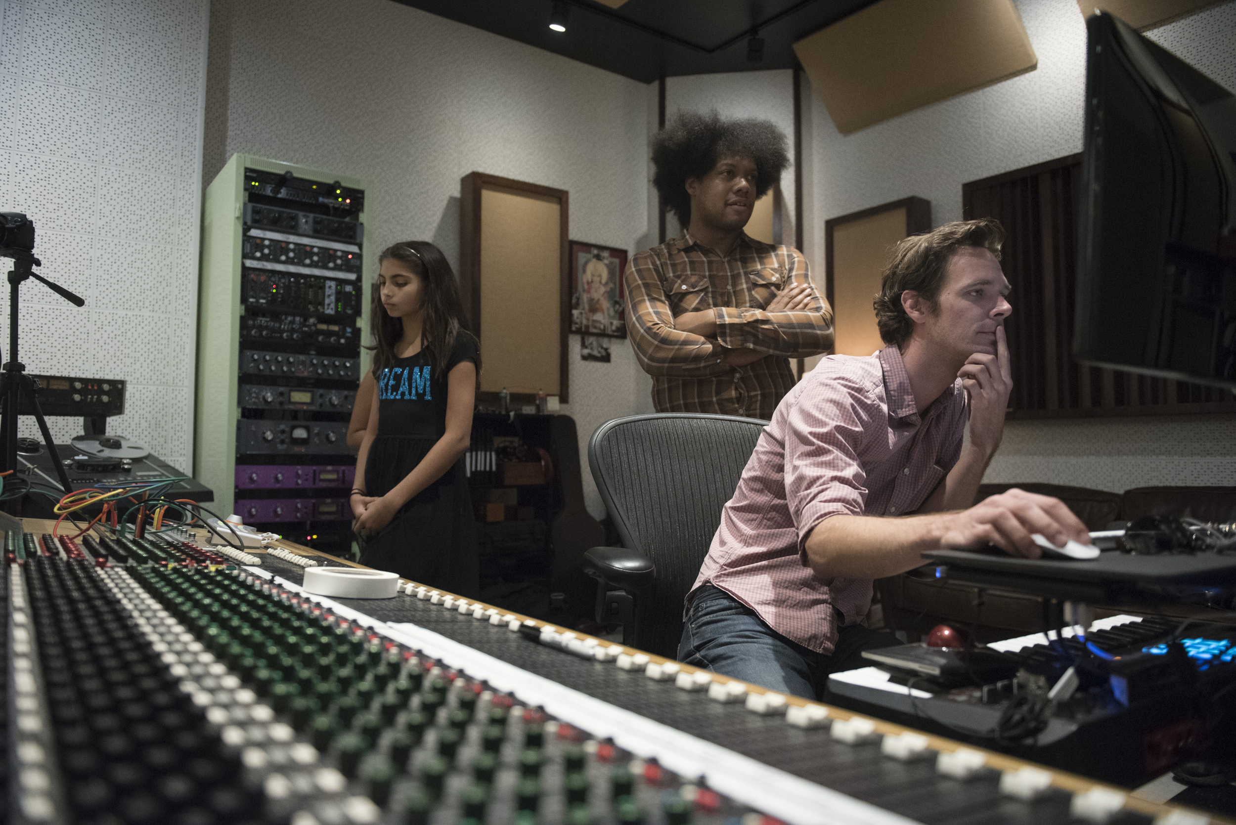 "From left, Ava Thrasher, 10, Diego Cano, and Mike Weller listen to a take of Thrasher's song ""remember"" at National Southwestern Recording in Las Vegas, Thursday, July 16, 2015.(Jason Ogulnik/Las Vegas Review-Journal)"