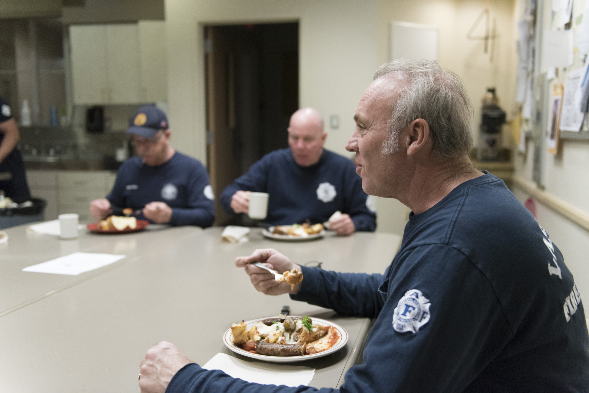 From right, Firefighter Ted Ramey, Firefighter Tom Thomas and Captain Mickey Pedrol eat dinner at Las Vegas Fire & Rescue's Fire Station 41 in Las Vegas Monday, Jan. 11, 2016. The dinner consists of Italian stuffed shells, grilled sausage, garlic bread, green salad and banana cream pie. Jason Ogulnik/Las Vegas Review-Journal
