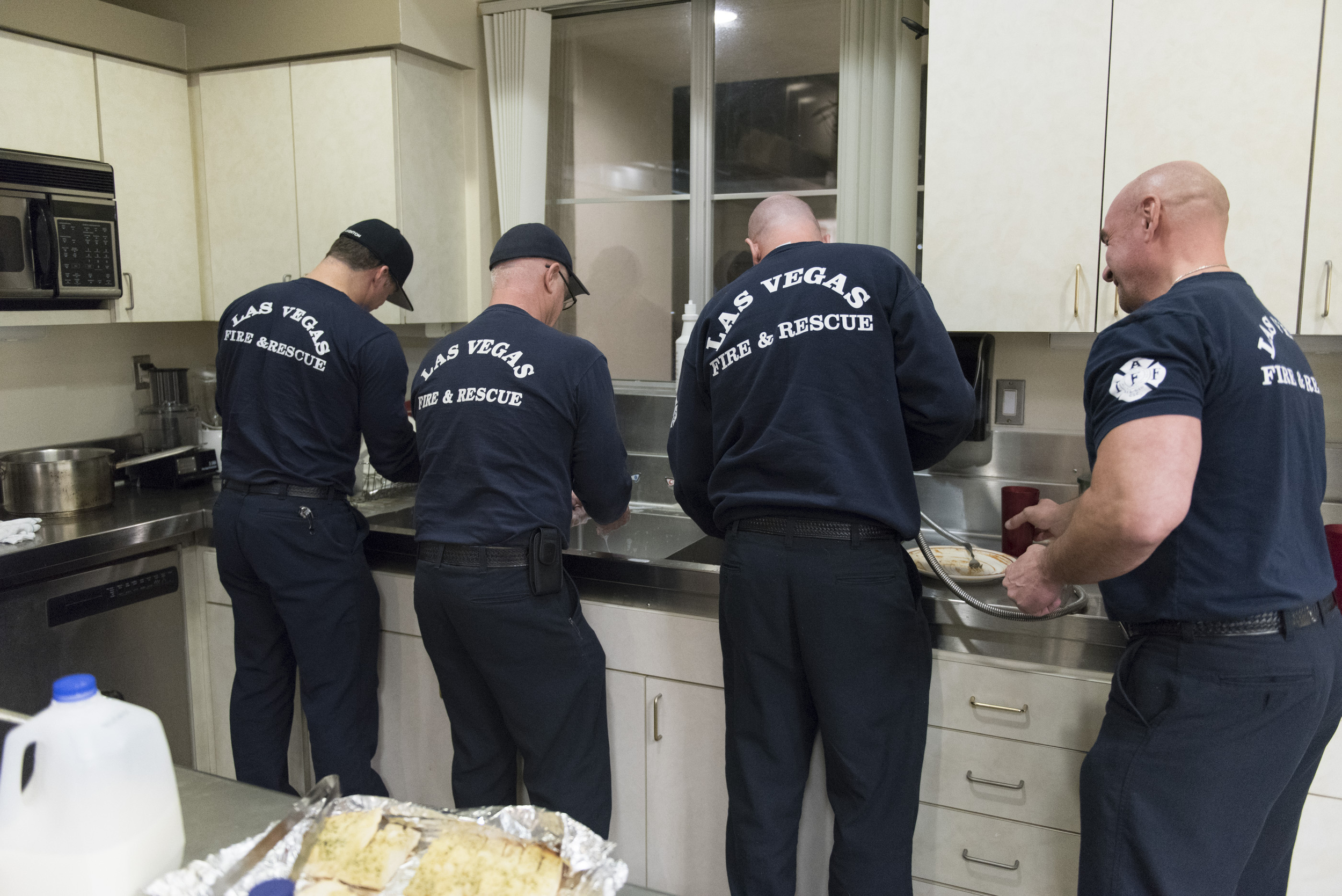 The crew washes dishes used during dinner at Las Vegas Fire & Rescue's Fire Station 41 in Las Vegas Monday, Jan. 11, 2016. Jason Ogulnik/Las Vegas Review-Journal