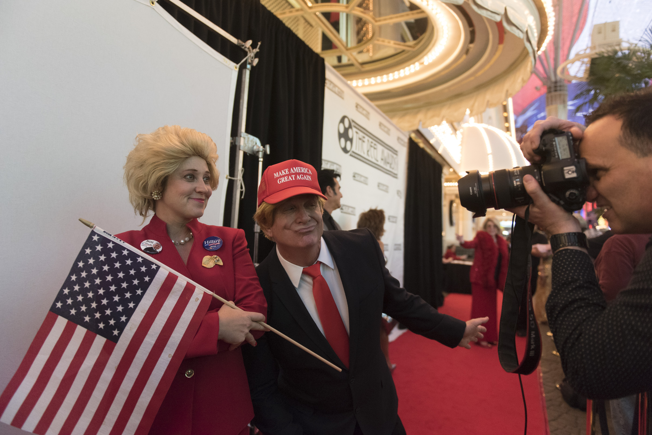 Hillary Clinton impersonator Darci Davis, left, is photobombed by Donald Trump impersonator Kevin Hartman, center, as  Roger Hutton takes a photo on the red carpet event ahead of The Reel Awards at Golden Nugget Hotel Casino in Las Vegas Monday, Feb. 22, 2016. The Reel Awards are meant to be a humorous tribute to the real Academy Awards. Jason Ogulnik/Las Vegas Review-Journal