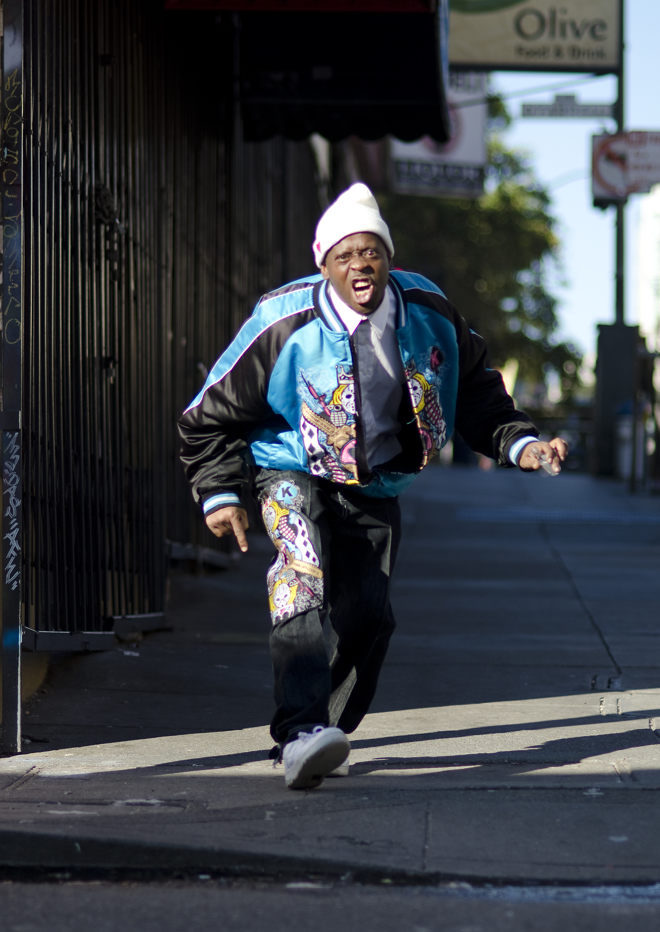 A stanger plays it up for the camera in San Francisco, Calif. Tuesday, Jan. 1, 2013.