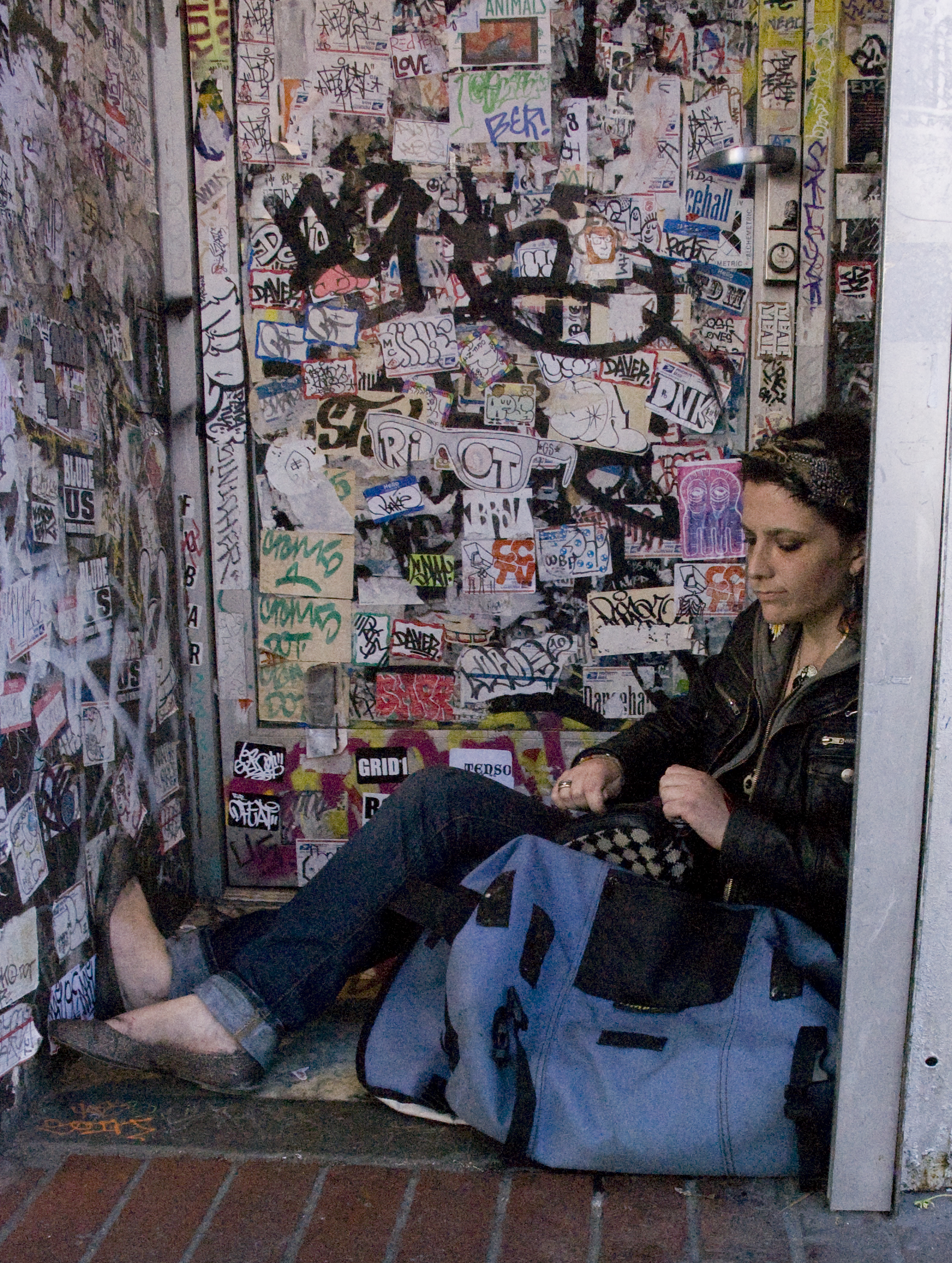 A woman sits in a doorway on Market Street at 6th Street in San Francisco, Calif.Wednesday, Nov. 2, 2011.