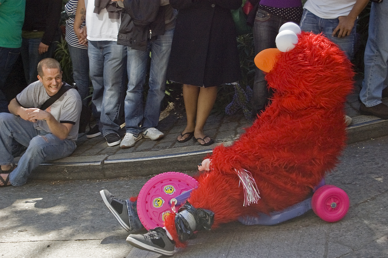 A racer rides the course down Vermont Street in an Elmo costume during the Bring Your Own Big Wheel race in San Francisco Sunday, April 12, 2009.
