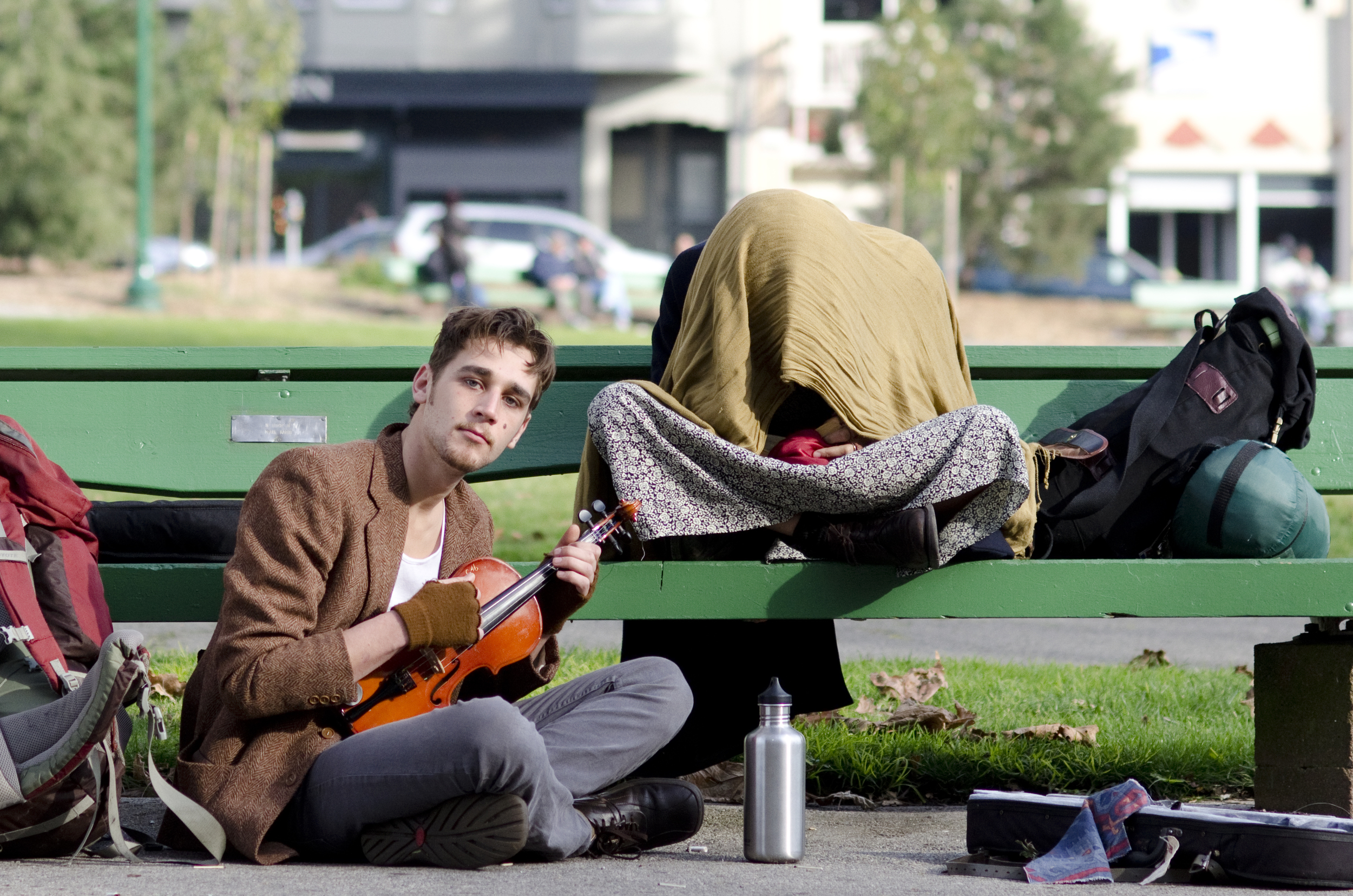 Travelers hang out at Washington Square in San Francisco, Calif. Monday Jan. 3, 2013